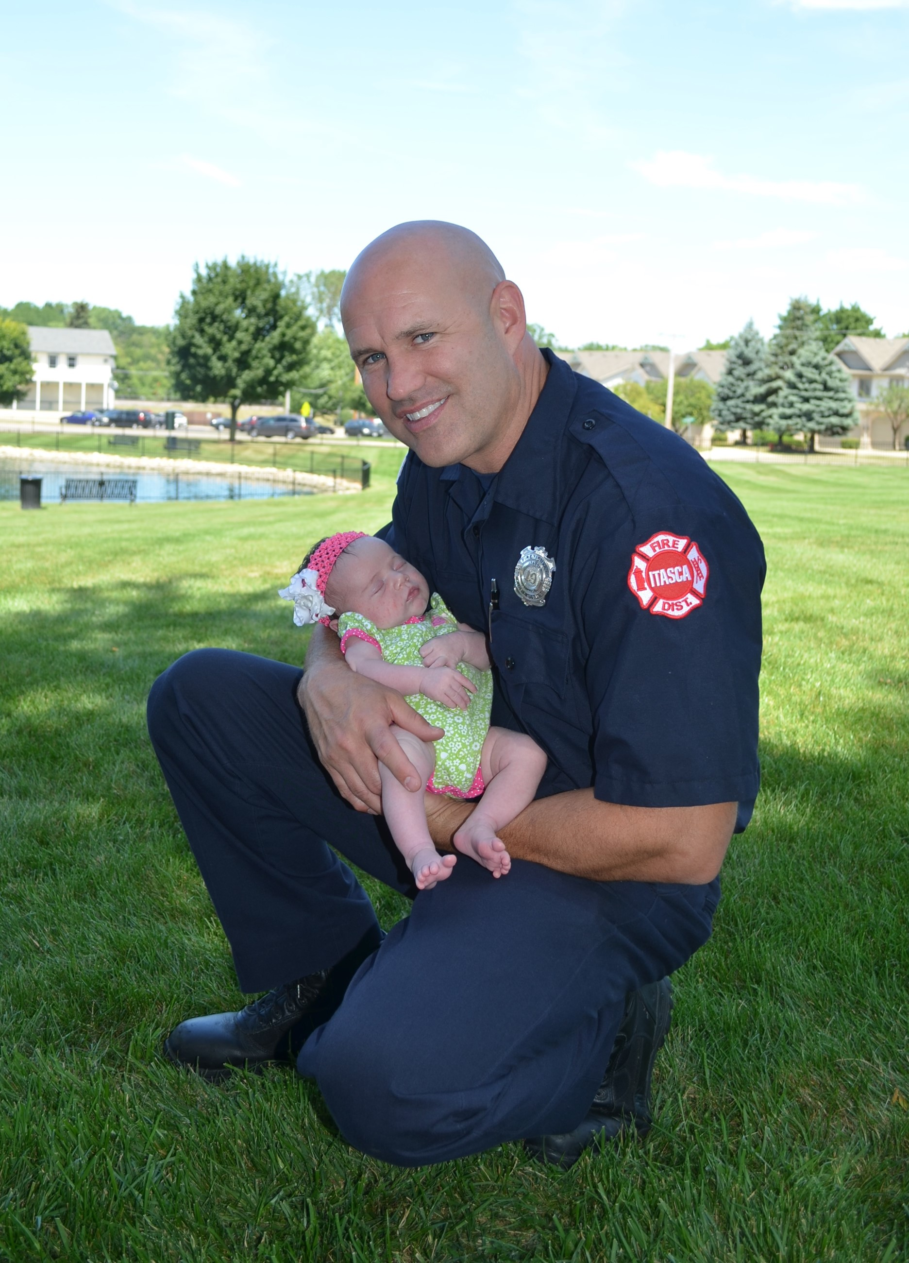Itasca Pk Dist Fireman with baby.JPG