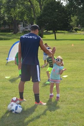 Little girl at soccer camp