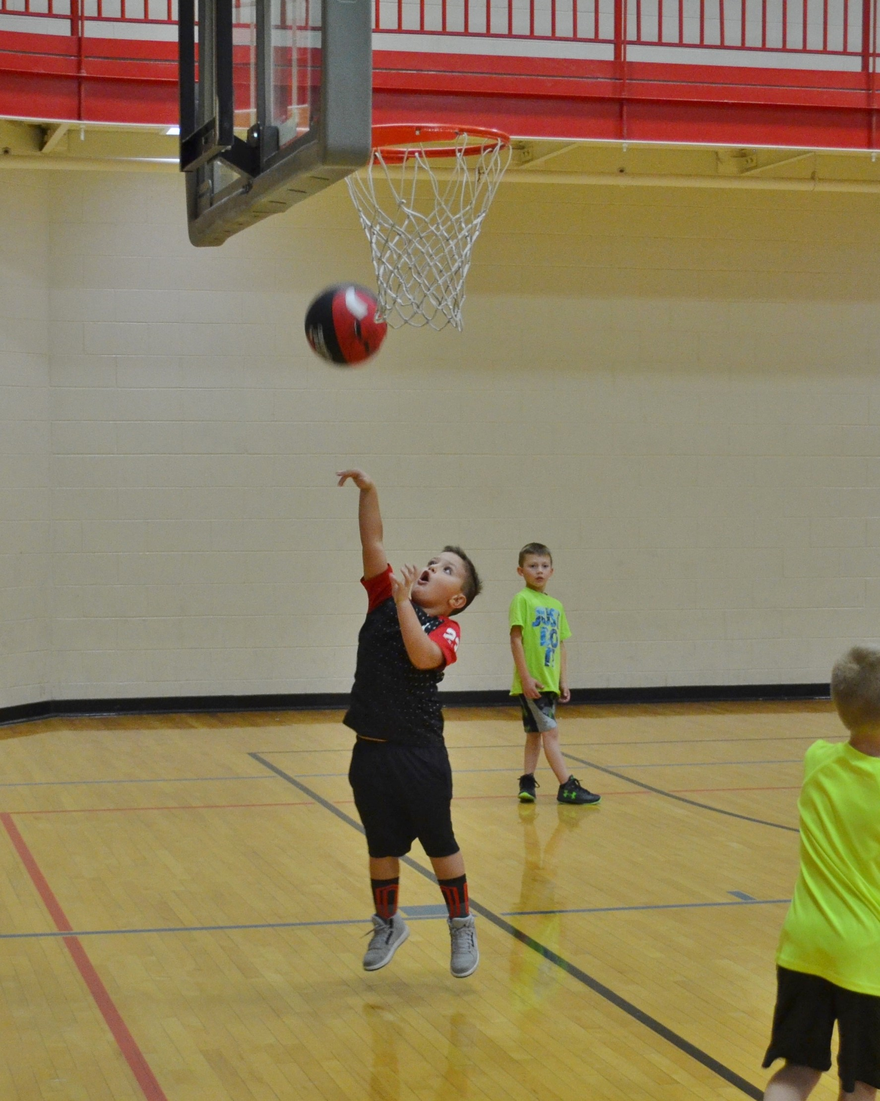 Boy shooting a basketball.JPG