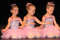 3 Little Girls On Stage in Sparkly Pink Ballerina Costumes