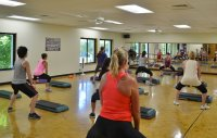 Group Fitness class with women and light weight dumbbells