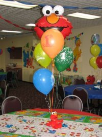 Elmo balloons at a birthday party