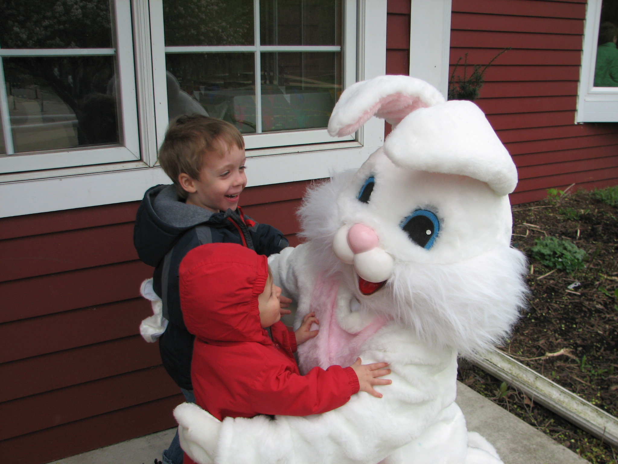 Children Hugging Easter Bunny